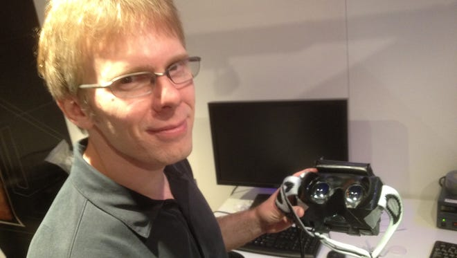 John Carmack showing off the Oculus Rift VR headset prototype at the Electronic Entertainment Expo in L.A. in June 2012.