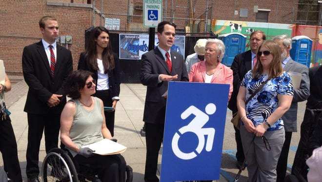 State Sen. David Carlucci, who represents most of Rockland and part of Westchester, speaking at a press conference called to pressure Gov. Andrew Cuomo to sign legislation to replace old handicapped signs with new accessibility signs depicting a wheelchair in motion.