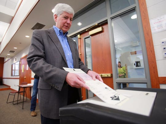 Michigan Gov. Rick Snyder votes during the special election for Proposal 1 at a voting center in Superior Township on Tuesday, May 5, 2015.