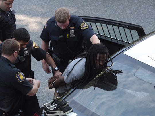 Police from Yonkers, Westchester County, Greenburgh and State, at the scene of a vehicle stop involving two individuals south in connection in the shooting of a retired police officer in Greenburgh who stumble upon a burglary on July 13, 2015. The car was stopped on the southbound lane on the Bronx River Parkway in Yonkers. Both individuals were detained by police.