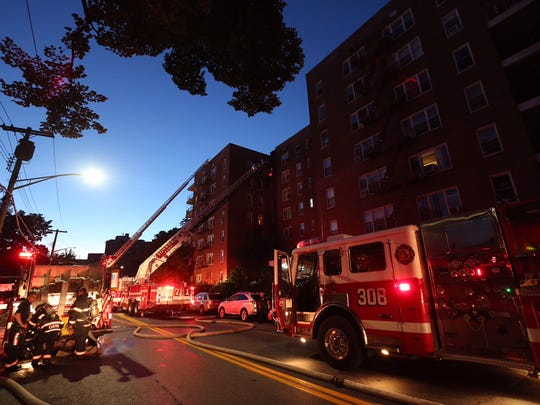 Yonkers firefighters at a three-alarm fire at 200 Valentine Lane early Friday