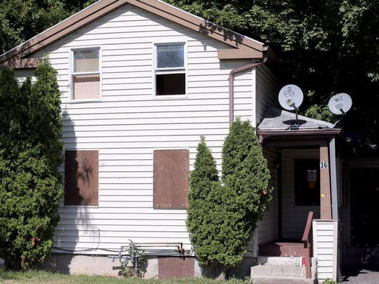 The house at 36 Woodward St. where two people were shot and killed at a party on Sept. 12, 2015.