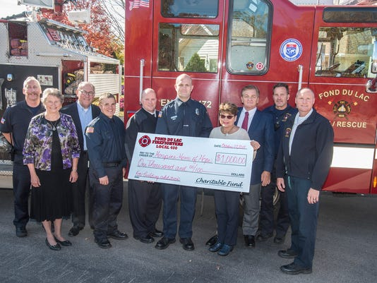 635817294493136237-Hospice-Home-Fire-Fighters-Donation-10222015