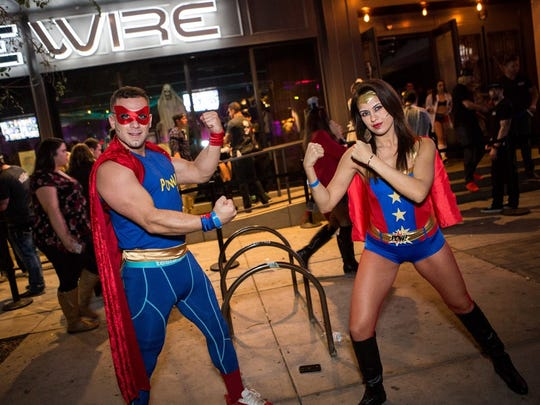 These superheroes duked it out at the Ghostball Block Party in Old Town Scottsdale on Oct. 31, 2015.