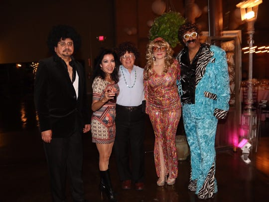 Dr. Robert Vera, Martha Vera, Dr. Harvey Greenberg, Dr. Maria Larrazaleta and Dr. Sal Saldivar dressed up for the Throwback Thursday fundraiser for the Rio Grande Cancer Foundation.