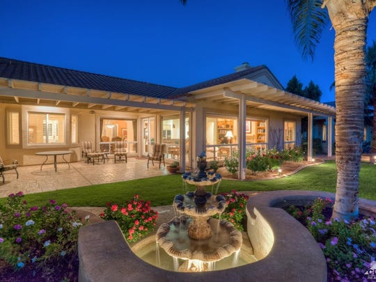 The back patio of a Sun City Palm Desert home, which includes its own misting system for outdoor dining in the summer.