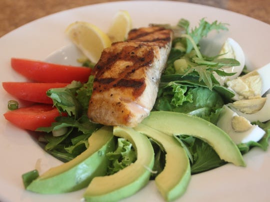 Salads at Florida Kitchen in Miromar Outlets in Estero, including the salmon avocado salad.