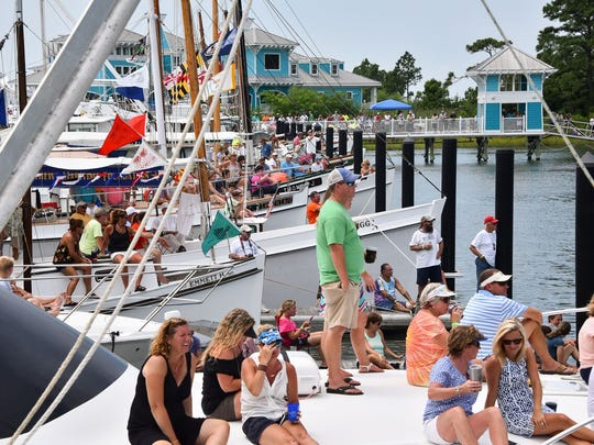Spectators gather in the Oyster Farm Marina at Kings Creek to watch the boat docking contest on August 7, 2016.