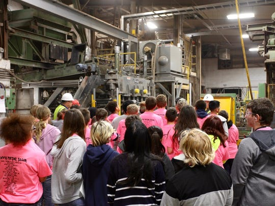 Eighth-grade students at John Muir Middle School observe the manufacturing process for concrete masonry units at County Materials' Marathon facility. They learned how water, sand and aggregate materials are transformed into structural block.