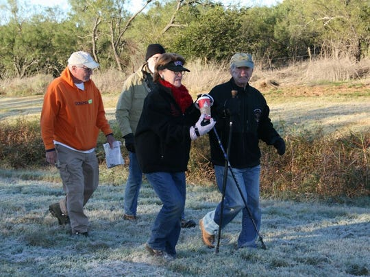Randy Barnett, left, hikes with another citizen and Mary and Larry Gill, of Abilene, along Cedar Creek during the Mayor's Fall Hike 2016 on Saturday.