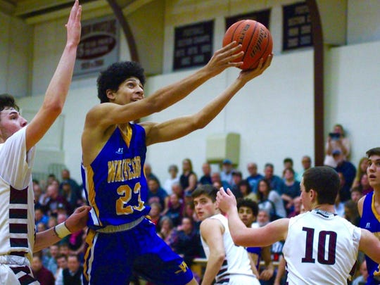 Waynesboro's Jay Alvarez fights for a layup