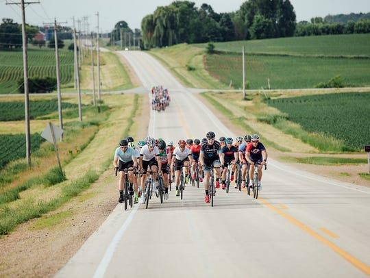 Riders participate in the Trek 100 last year.