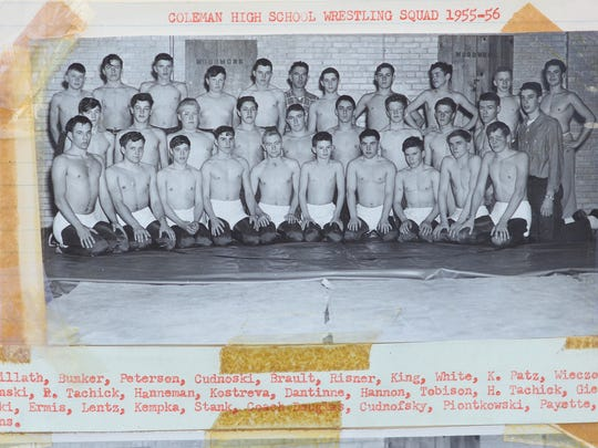 Coleman's inaugural year of wrestling took place during the 1955-56 season. Coach Jim Douglas, back center, held practices in the school's woodshop.