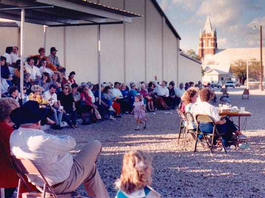 A crowd gathers for the auction at the 67th annual Fall Festival (1989) of St. Joseph Parish in Rowena.