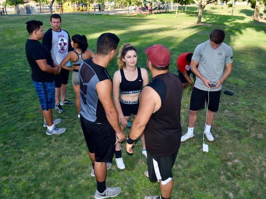High school and university students gather at Young Park to participate in a practice session for local cheer-squad athletes, July 7, 2017.