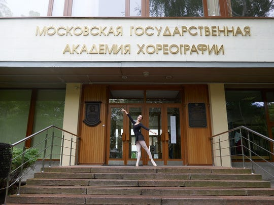 Emilie Scott strikes a pose in front of the Moscow State Academy of Choreography, the teaching arm of the Bolshoi Ballet.