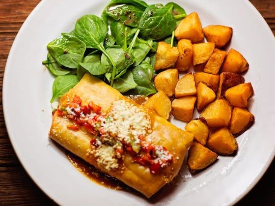 Senor Tomas' Chimi del Sol is a chimichanga served with plancha potatoes and spinach.