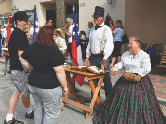Historical re-enactors Talissa L. Wilson, right, and James B. Odell greet attendees during the 2017 Treasure Coast History Festival. The inaugural festival was co-sponsored by Main Street Fort Pierce and the Sunrise Theatre. Indian River Magazine also presented the festival as part of its 10th anniversary celebration.