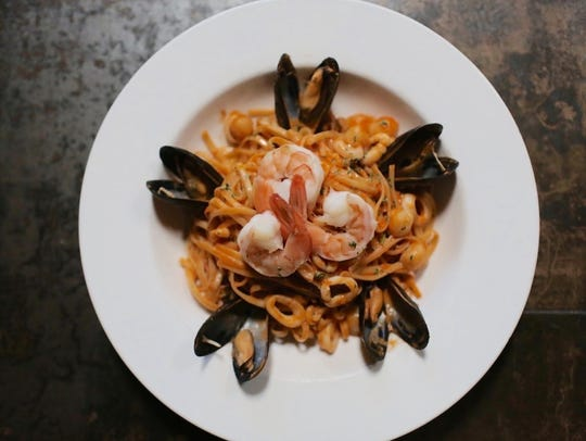 Chef David Baruthio closed his Prime Land & Sea in late summer. This photo shows the restaurant's seafood linguini dish.