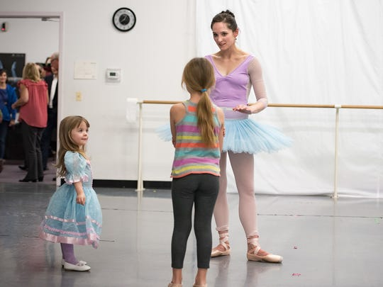 Jessica Tretter shares feedback with young dancers.