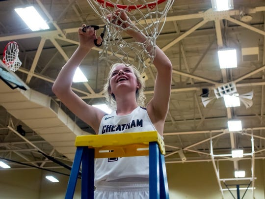 Abbi Douglas cuts down the net after Cheatham County