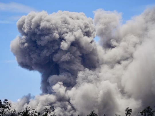 Smoke from the Kilauea volcano fills the sky on the