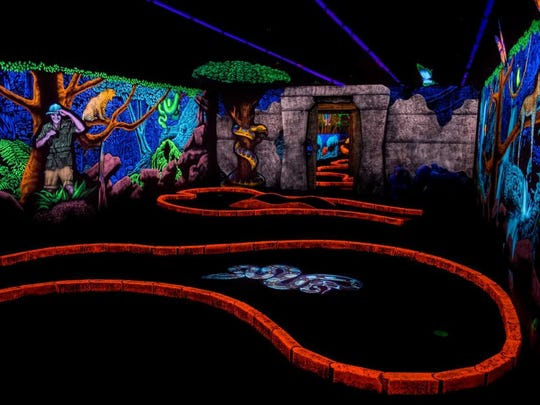 Swinging Safari in Chandler is 18 holes of glow in the dark miniature golf.