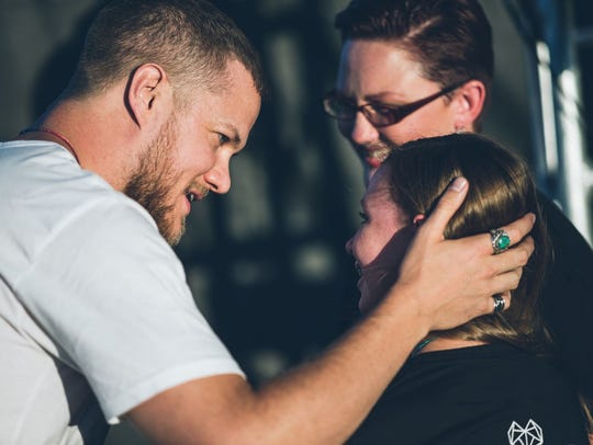 Dan Reynolds greets Savannah and her mother, Heather