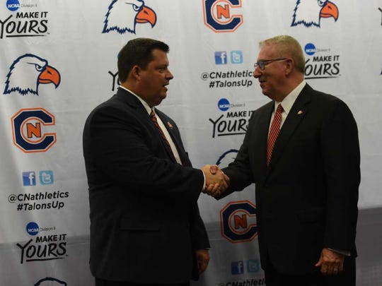Carson-Newman athletic director Matt Pope is congratulated by University President Randall O'Brien after being introduced on Monday in Jefferson City on Monday, July 9, 2018.