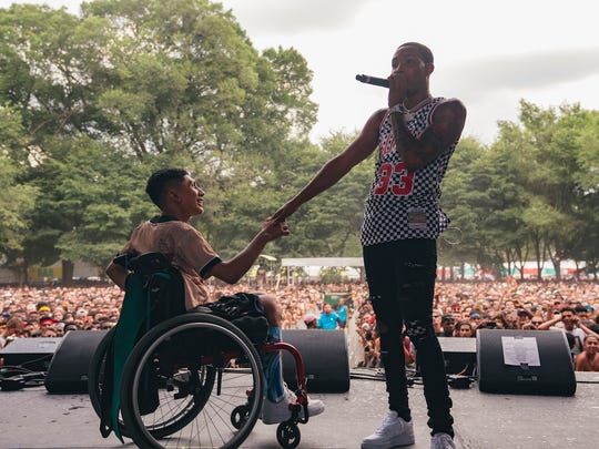 G Herbo invited a fan who crowdsurfed in his wheelchair during his Lollapalooza set Thursday onto the stage.