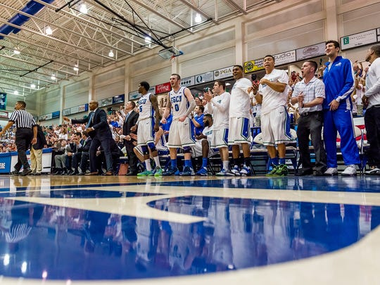 Jamill Jones, standing with right arm outstretched, was at FGCU under Joe Dooley from 2013-15.