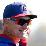 Texas Rangers manager Jeff Banister (28) watches bullpen practice during spring training camp at Surprise Stadium.
