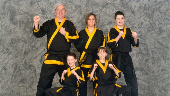The members of the O'Callaghan family -- Kathy O'Callaghan and her husband Mike, with Christopher, 15 (standing); Mary Kate, 12; and Ryan, 10 -- take karate together, and not just for kicks.