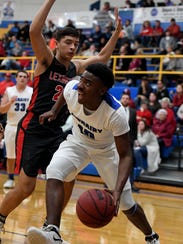 McNairy's Omari Robinson drives to the basket while