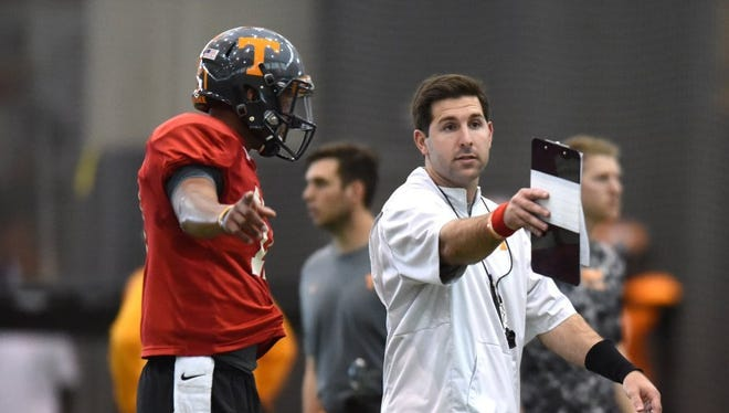 ADAM LAU/NEWS SENTINEL Tennessee offensive quality control coach Nick Sheridan, right, works with quarterback Joshua Dobbs during spring practice. Tennessee offensive quality control Nick Sheridan, right, works with Tennessee quarterback Joshua Dobbs (11) during spring practice at Anderson Training Center on Thursday, March 31, 2016.