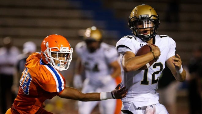 Central's Nick Severson chases Abilene High quarterback Peyton Killam last season at San Angelo Stadium. The Bobcats rolled to a 63-26 win on their home field. Abilene will host this year's meeting at Shotwell Stadium.