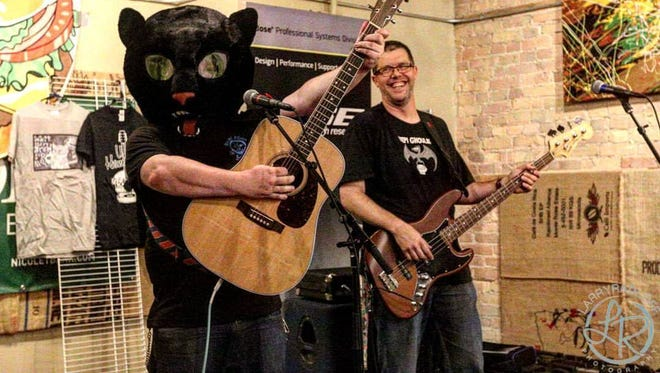 Musician Walt Hamburger doesn't typically perform in his cat mascot head, but he does pass it around at all of his shows to raise money for area animal shelters. Catch him Thursday with Beach Patrol at Brickhouse Craft Burgers & Brews in De Pere.