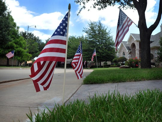 Flags big and small line the streets and sidewalks of homes in the Tamarron neighborhood Wednesday as residents marked Flag Day.