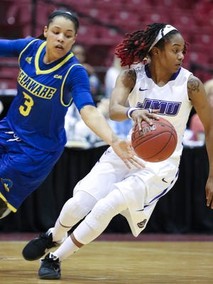 Delaware's Erika Brown tries to chip the ball away from James Madison's Angela Mickens in the first half of a CAA tournament semifinal at the Show Place Arena in Upper Marlboro, Md. Friday.