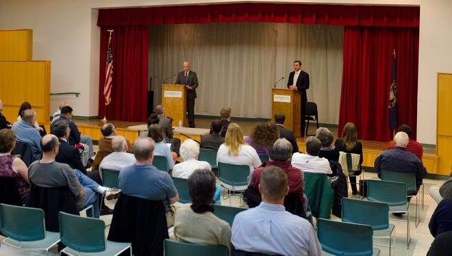 Democratic candidate Bob Goodrich and U.S. Representative Justin Amash engage in a civil debate in the Lew Boyd room of the Burnham Brook Community Center on Tuesday.