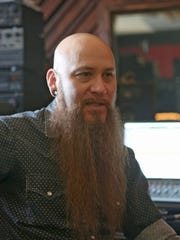 Musician Arthur Seay talks about his career in music in his studio in Indio in August 2014.