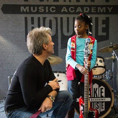 Jon Bon Jovi chats with a student at Lakehouse Music