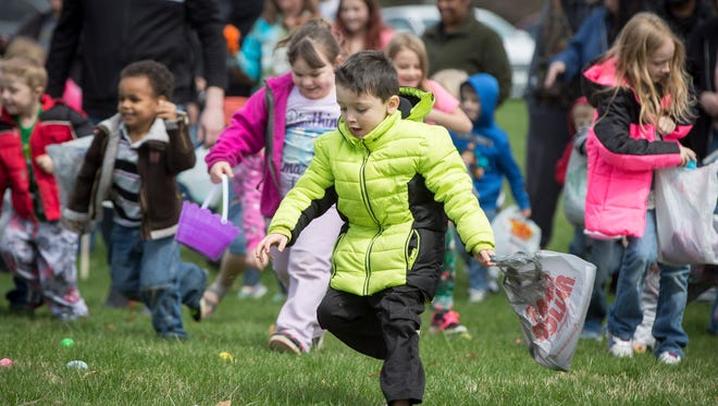 Children play games and take photos with the Easter Bunny at Thomas Park on April 1 during an Easter celebration put on by Heavenly Angels and Faith Builder Ministries.