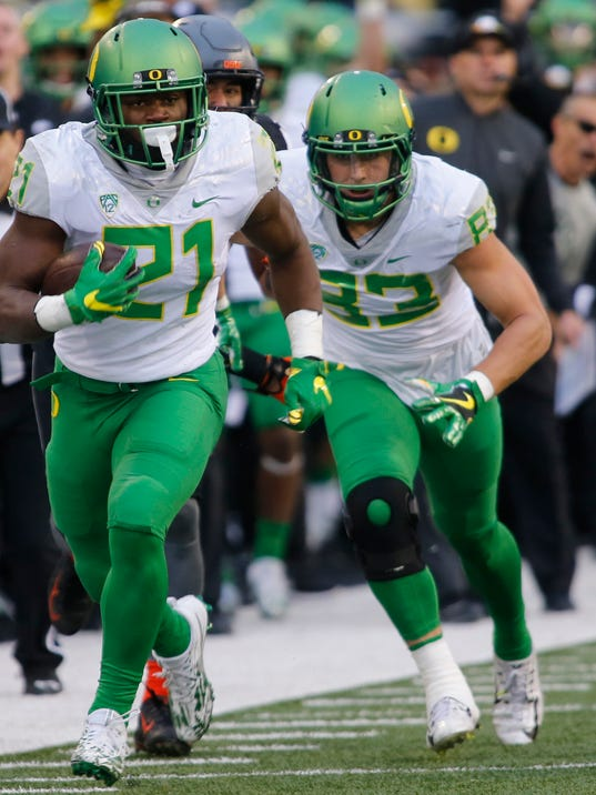 Oregon running back Royce Freeman (21) heads upfield in the second half an NCAA college football game against Oregon State, in Corvallis, Ore., Saturday Nov. 26, 2016. (AP Photo/Timothy J. Gonzalez)