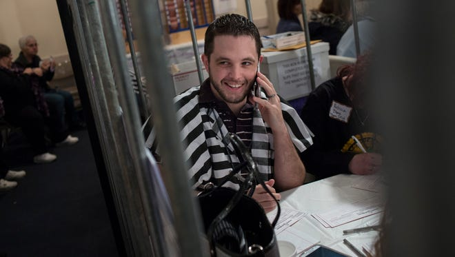 Pat Wells, of Fort Gratiot, makes calls with others from team Community Mental Health during the March of Dimes Jail and Bail Saturday, Feb. 6, 2016 at the Port Huron Masonic Temple.