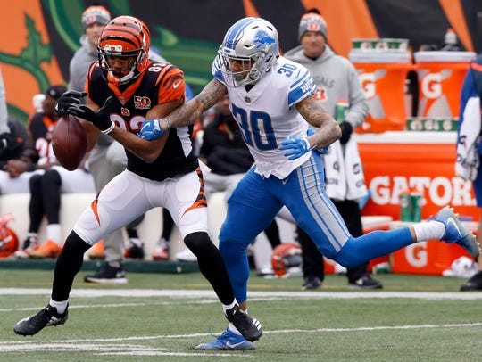 Teez Tabor battles the Bengals' Tyler Boyd during a game last season.