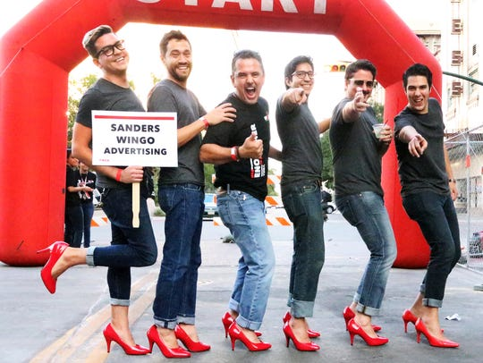 """A group of young men prepare to """"Walk A Mile In Her"""