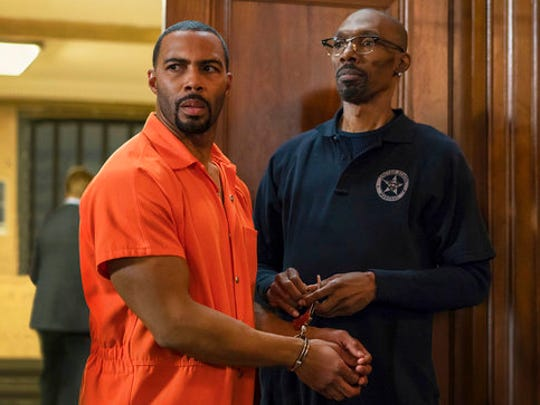 """This image released by Starz shows Omari Hardwick, left, with Charlie Murphy in a scene from the original series, """"Power."""" Murphy, older brother of actor-comedian Eddie Murphy, died Wednesday, April 12, 2017 of leukemia in New York. He was 57."""