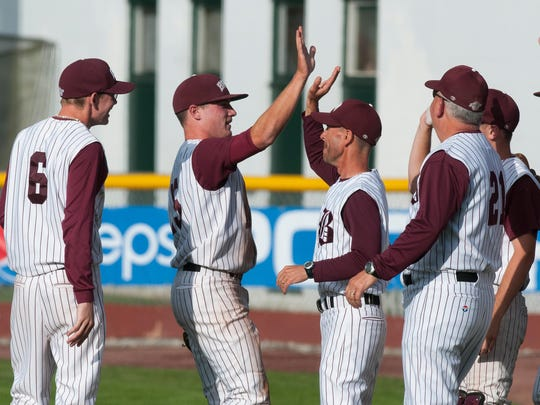 Teammates congratulate BFA-Fairfax pitcher Alex Chapman between innings during the Division III high school baseball championship game against Poultney last year.