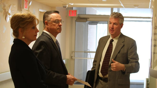 Todd Linden, president and CEO of Grinnell Regional Medical Center, right, points out an area of interest to U.S. Representative Rod Blum, center, and his wife, Karen, during a tour of the facility on Thursday, Jan. 28.